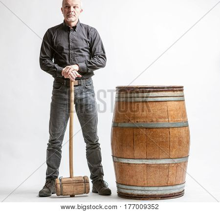 Man With Hammer And Barrel