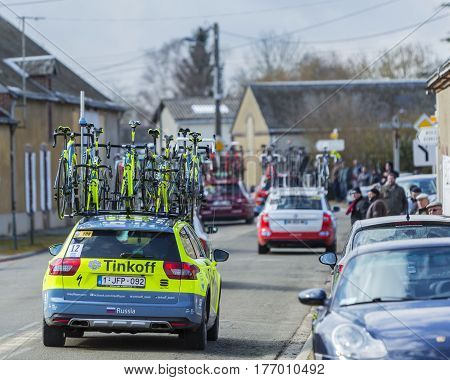 Le Gaut Saint DenisFrance- March 72016: The caravan of technical cars passing through a small village in Eure et Loire region of France during the first stage of Paris-Nice 2016.