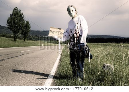 chainsaw murderer trying to get a ride. any destination is fine for him.