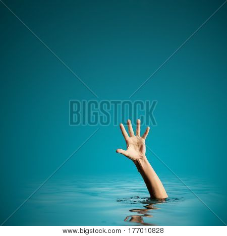Hand on sea water background asking for help