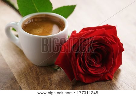 fresh espresso with red rose flower, romantic morning photo