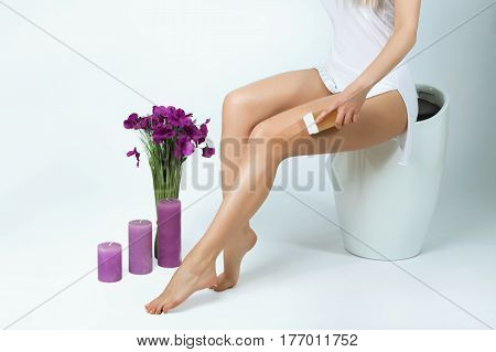 Beautiful slender female legs with silky skin hair removal depilation shugaring.