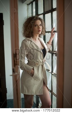 picture of lovely sexy woman .young girl in coat.Fashion woman in coat.Slim young fashion model wearing white coat.portrait of young beautiful fashionable woman