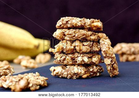 Banana Cookies With Walnuts And Oats On Dark Background