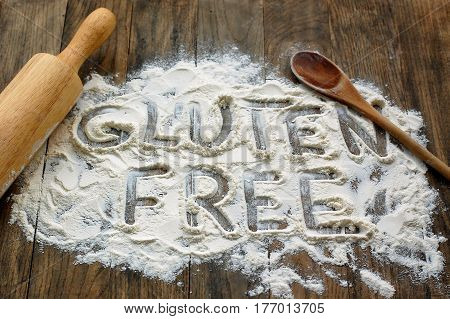 Gluten Free Flour With Text Gluten Free In English Language With Wooden Spoon And Rolling Pin On Dar