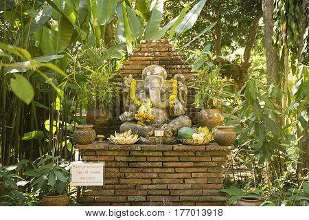 Religious elephant stone sculpture of Ganesha god in garden Thailand. Sculpture/symbols of Buddhism.