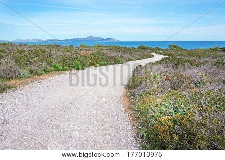 Gravel road towards the sea in north Mallorca Balearic islands Spain.