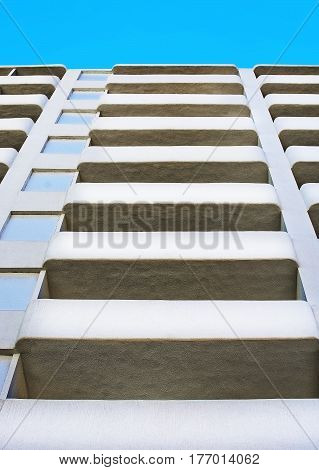 Abstract architecture detail of white highrise building with blue sky in Palma de Mallorca Spain.