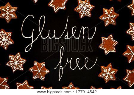 Gingerbread Christmas Cookies Stars And Snowflakes With White Icing With Text Gluten Free On Black B