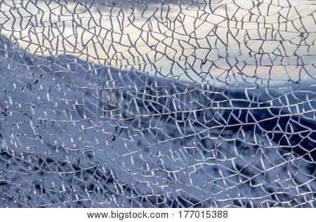 texture broken glass, mountains in background, winter