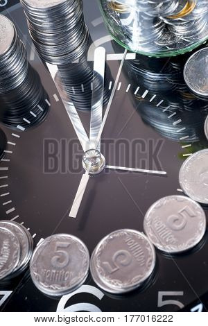 coins with plant and clock isolated on white background. savings concept concept of time and money. copy space for text.