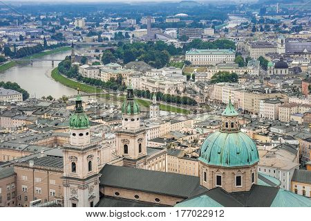 Beautiful aerial view of Salzburg with Festung Hohensalzburg and Salzach river in rainy summer day, Salzburg, Salzburger Land, Austria