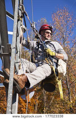Climber ascending the 400 feet cellular tower
