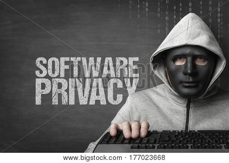 Software piracy text on blackboard with hacker