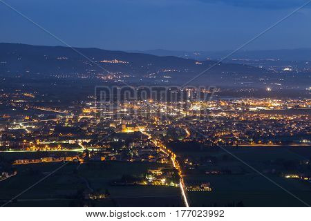 Panorama of Assisi at night. Assisi Umbria Italy.