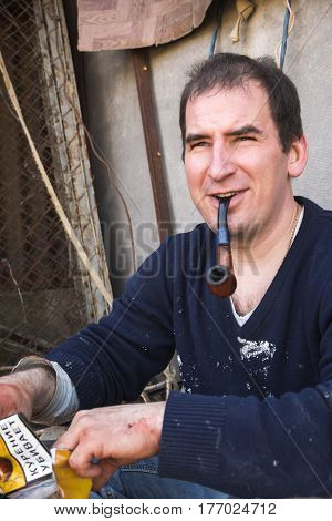 Russian Smiling Butcher Smokes Pipe