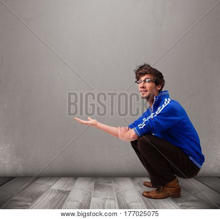 Handsome young man presenting an empty copy space