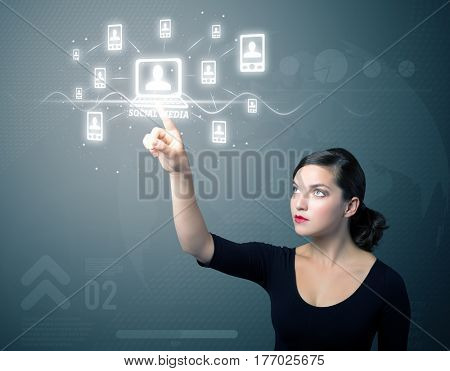 Businesswoman pressing modern social buttons on a virtual background