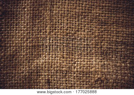 Natural textured burlap sackcloth hessian texture coffee sack, dark country sacking canvas, macro background