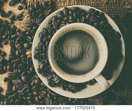 Top view coffee cup with beans on the table