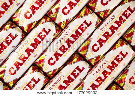 Southampton, UK - 17 March 2017: A background of Tunnock'??s Caramel Wafer biscuits, a popular milk chocolate coated snack.