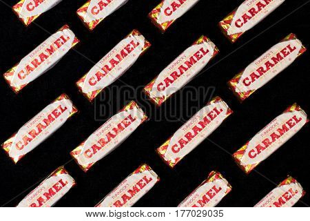 Southampton, UK - 17 March 2017: A background of Tunnock's Caramel Wafer biscuits, a popular milk chocolate coated snack.