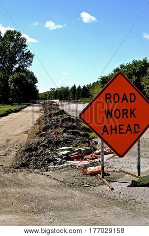 Sidewalk. curb, and street repair is given public notice by a sign of