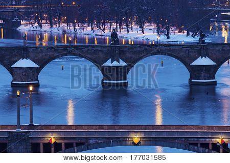 Winter in Prague - bridges on Vltava River. Prague Bohemia Czech Republic.
