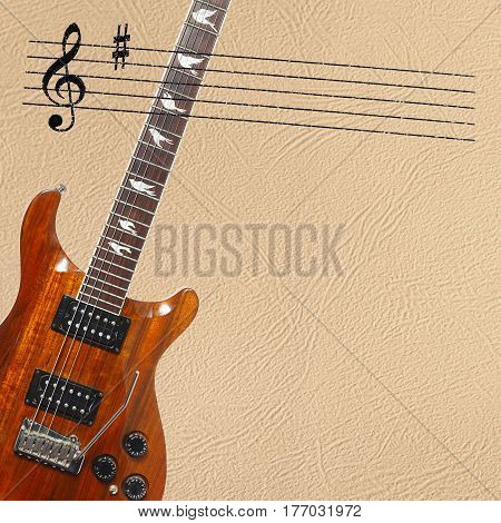 Stave and exotic wood electric guitar on the left side of the light skin background.