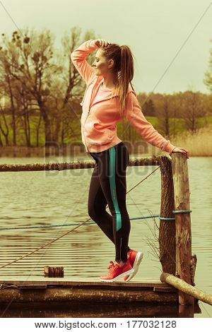 Young Sports Woman Taking Break After A Run.