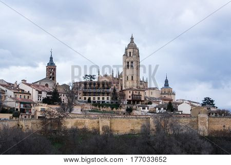 An iconic view to the center of Segovia Cathedral and old medieval buildings over the hill Segovia Castille and Leon Spain.