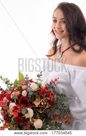 Portrait of gorgeous girl with flowers wearing beautiful jewellery