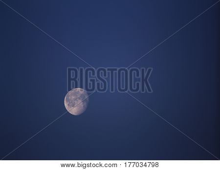 A moon shining in the night sky