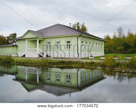 Scenic views of pond and green house-museum of the 19th century in the town of Dmitrov Russia.