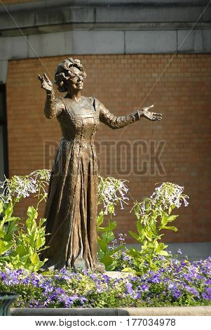 Oslo Norway - July 22 2014: Statue of Norwegian actress Wenche Foss in park outside National Theatre