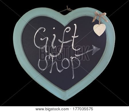 Hanging wooden heart with a chalkboard centre with Gift Shop and an arrow written on it and a small cream hanging heart.