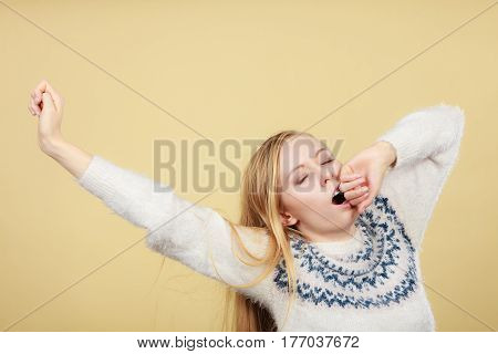 Sleepy Yawning Teenage Woman In Jumper