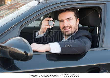 Man Holding A Car Key Seated In  His Vehicle