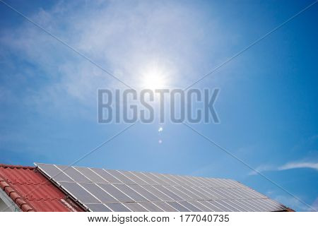 Solar panel and solar energy panel on red roof blue sky and sun light