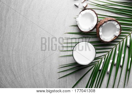 Composition with fresh coconut milk on light background