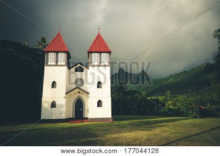 Rainbow on Haapiti church in Moorea island landscape. French Polynesia