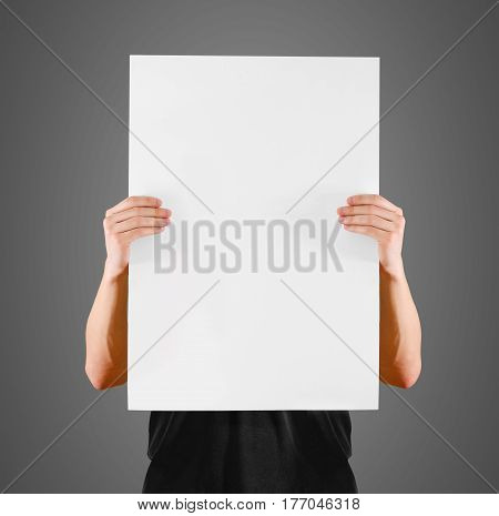 Man Showing Blank White Big A2 Paper, Covers The Face. Leaflet Presentation. Pamphlet Hold Hands. Ma