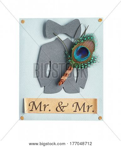 Wedding boutonniere with peacock feather and card isolated on white