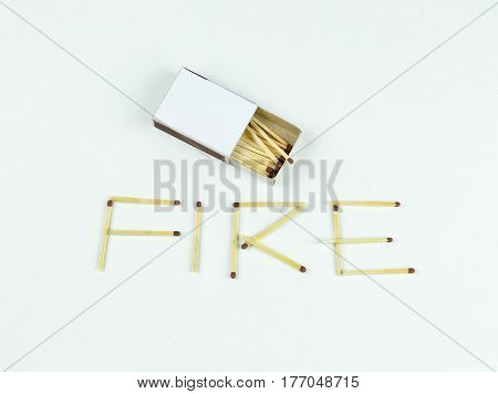 Closeup Outdoor White Boxes Of Matches. Scattered Matches. Matches Laid Out The Word Fire. Isolated