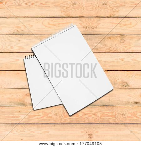 Two Blank White Spiral Bound Paper Drawing Pad With Shadow On A Wooden Table