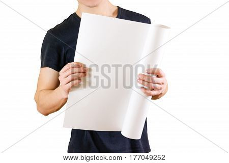 Guy Holds In His Hands Twisted Up In Paper. Opens The Package Of Paper. Shows A Blank Sheet Rolled I