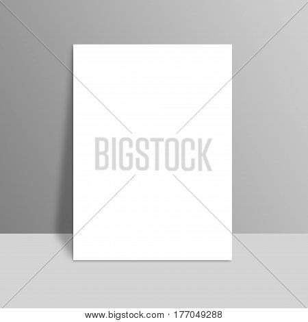 White Blank Stationary Near The Grey Wall With Shadow. Close Up Magazine, Book, Brochure, Flyer, A4