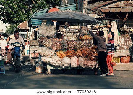 Vietnamese Street Vendor At Cho Lon Market,