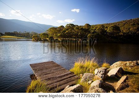 The sun sets over Lake Crackenback on a cool autumn evening in New South Wales, Australia