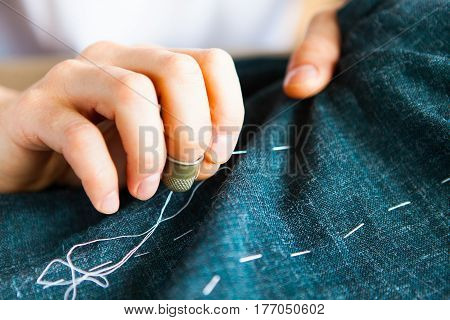 Tailor Man Working In His Tailor Shop